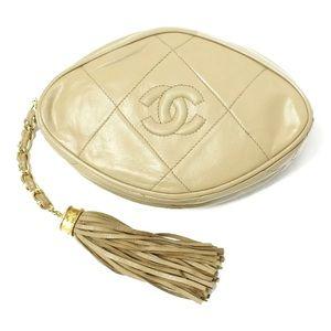 Chanel vintage oval clutch pouch tassel lambskin